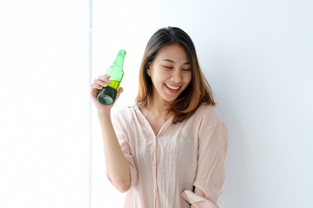 Young asian woman drinking beer at party, celebration, people and lifestyle