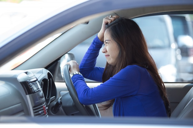 Young asian woman driving