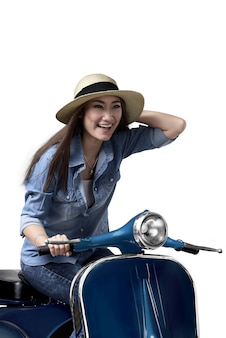 Young asian woman enjoying riding scooter