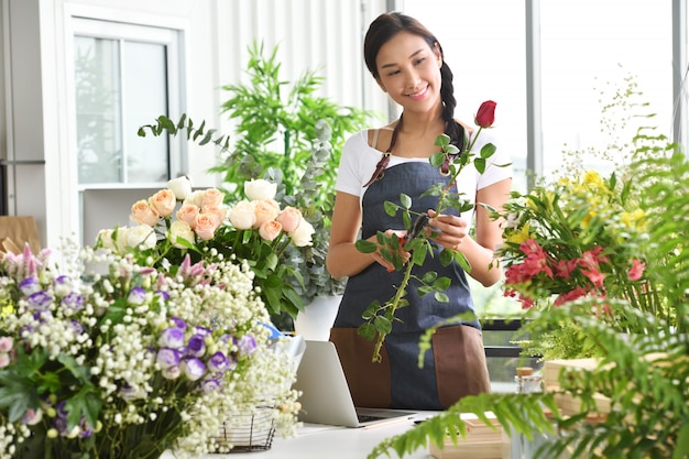 Young asian woman entrepreneur, shop owner, florist of a small flower shop business