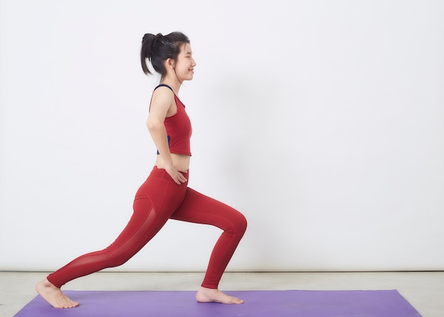 Young asian woman exercise over light background