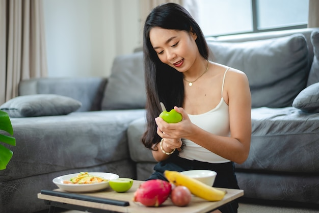 Young asian woman girl holding health food fresh vegetable in lifestyle at home, female beautiful vegetarian person doing diet nourishment eat salad meal, people are smile happy, healthy food concept