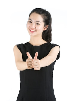 Young asian woman giving thumbs up