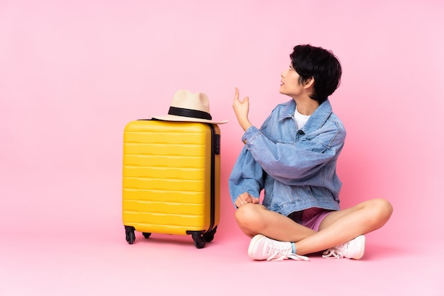 Young asian woman going to travel over isolated background