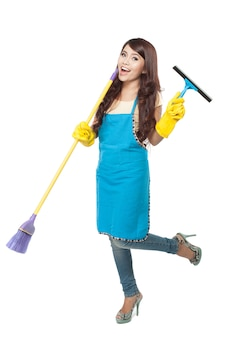 Young asian woman happily doing chores