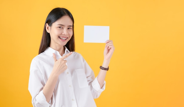 Young asian woman holding blank paper