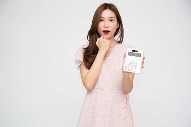 Young asian woman holding calculator