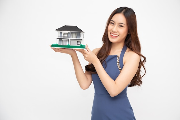 Young asian woman holding house model