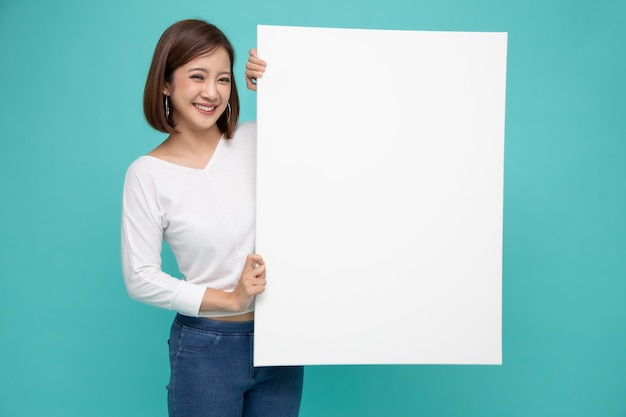 Young asian woman holding standing side the white big paper.