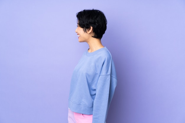 Young asian woman over isolated background