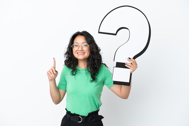 Young asian woman isolated on white background holding a question mark icon