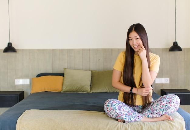 Young asian woman keeping an eye on you