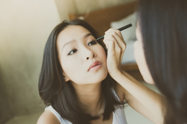 Young asian woman make up yourself