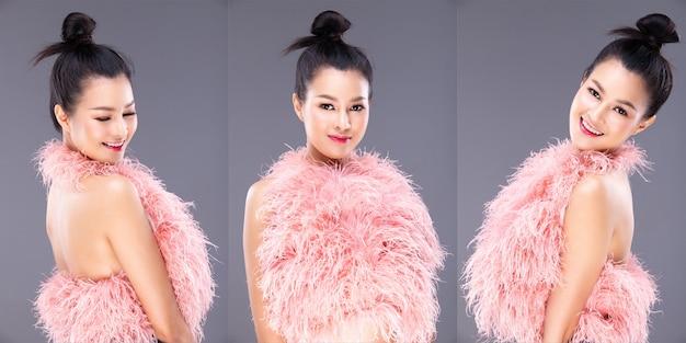 젊은 아시아 여성은 미소로 온라인 카탈로그 사진 촬영을 위해 깃털 핑크 파스텔 드레스 셔츠를 선물합니다. 20 소녀는 몸을 돌리고 바람을 불고, 스튜디오 조명 회색 배경을 격리하고, 많은 포즈를 합성합니다.