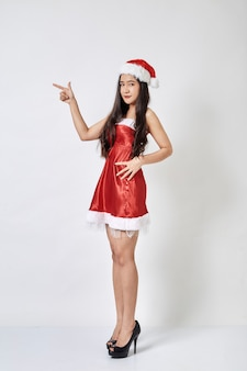 Young asian woman in santa hat on white