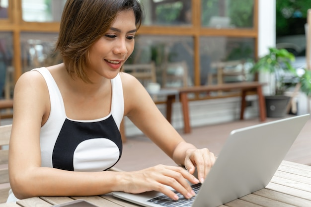 Young asian woman shopping online with laptop computer
