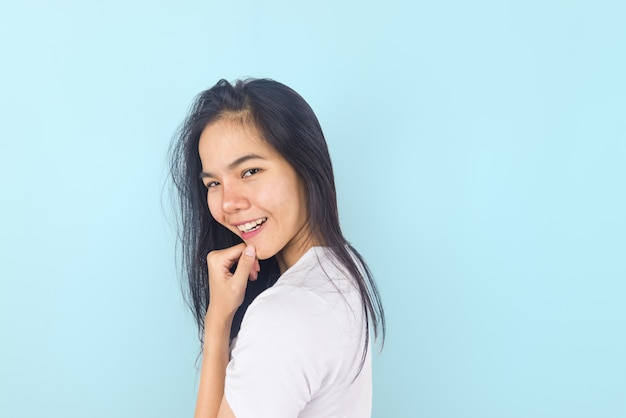 Young asian woman smile on blue background