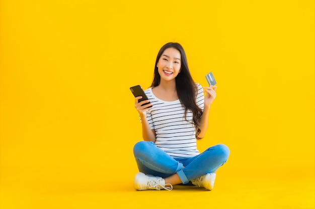 Young asian woman smile happy use smart mobile phone