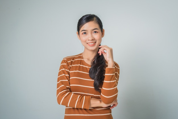 Young asian woman smiling with crossed arms