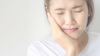 Young asian woman suffering from toothache