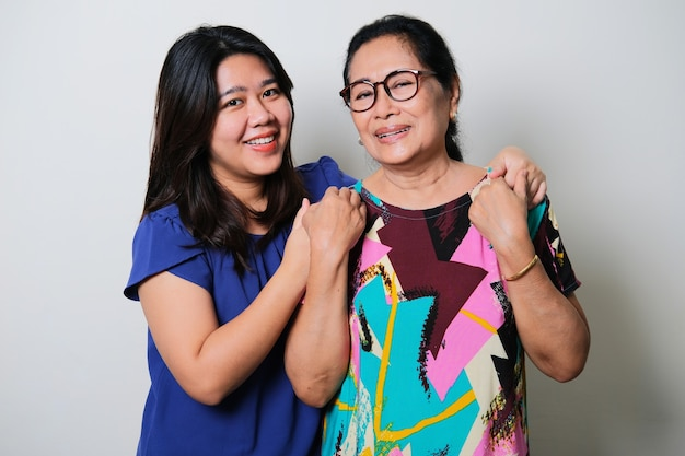 Young asian woman taking care her grandmother