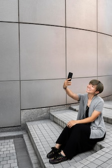 Young asian woman taking a selfie