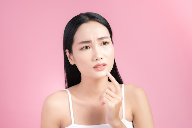 Young asian woman touch and worry about her face.