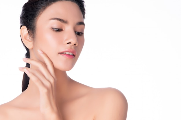 Young asian woman touching soft cheek and smile with clean and fresh skin