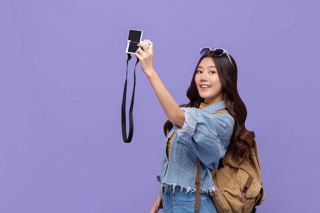 Young asian woman tourist taking selfie with camaera