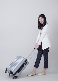 Young asian woman tourist with luggage to travel