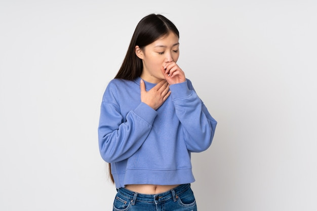 Young asian woman on wall coughing a lot