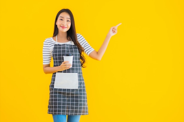 Young asian woman wear apron with smile happy