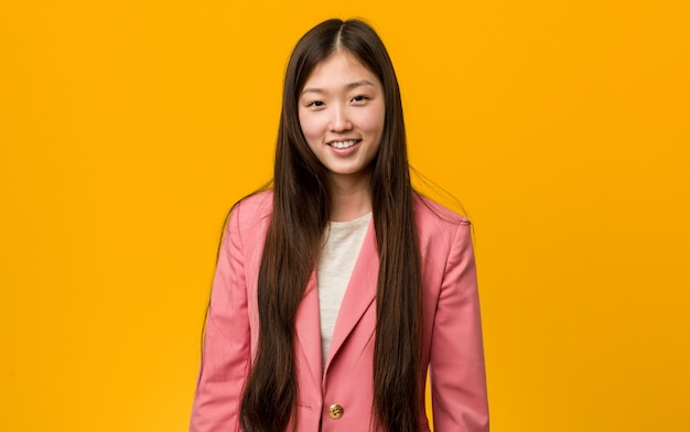Young asian woman wearing a business suit
