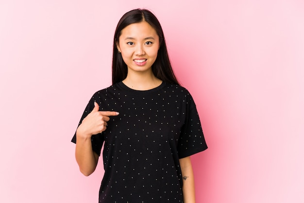 Young asian woman wearing elegant clothes isolated person pointing by hand to a shirt copy space, proud and confident