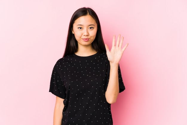 Young asian woman wearing elegant clothes isolated smiling cheerful showing number five with fingers.
