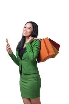 Young asian woman wearing formal shirt using the smartphone