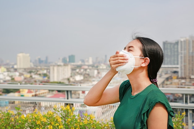 Young asian woman wearing a protection mask