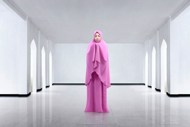 Young asian woman wearing veil and praying