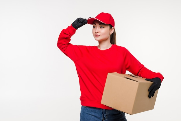 Young asian woman with delivery service worker in uniform. woman holding box with attractive smiling isolated.
