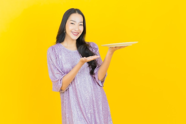 Young asian woman with empty dish