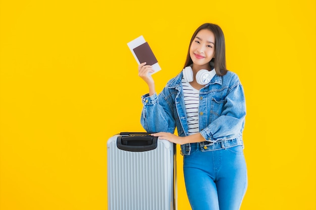 Young asian woman with luggage bag and passport