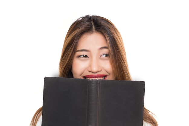 Young asian woman with smiley face with hand holding book isolated on white background.