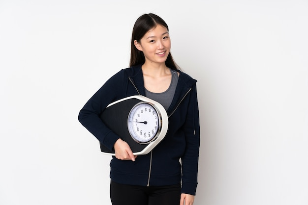 Young asian woman with weighing machine