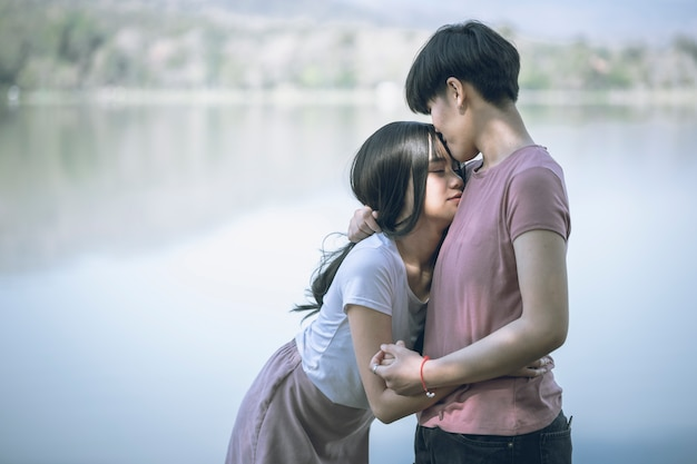 Young asian women lgbt lesbian romantic couple kissing in the morning.