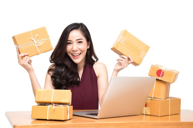 Young asian women with startup small business entrepreneur freelance working at home and excited about the orders of many customers, online marketing packing box delivery concept