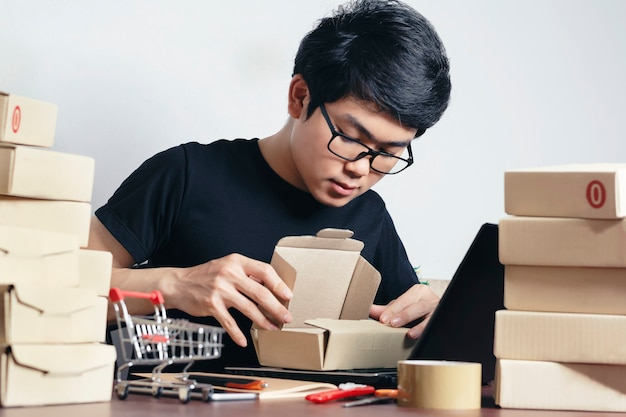 Young asians is packing for delivery to the customers