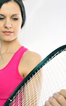 Young athlete girl holding her tennis racket