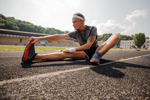 Young athlete makes stretch in the running track