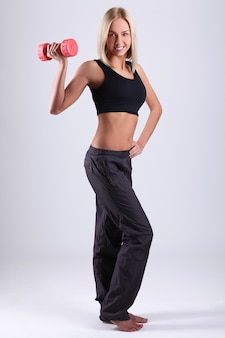 Young athlete woman with dumbbells
