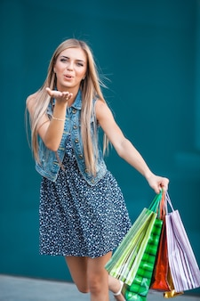 Young atractive woman with shopping bags outdoors